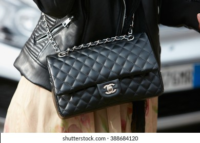 f5c711bd898 MILAN - FEBRUARY 24  Woman poses for photographers with Chanel black  leather bag before Gucci