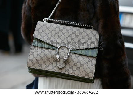13059ffe MILAN - FEBRUARY 24: Woman poses for photographers with Gucci bag before  Gucci fashion show, Milan Fashion Week Day 1 street style on February 24,  2016 in ...
