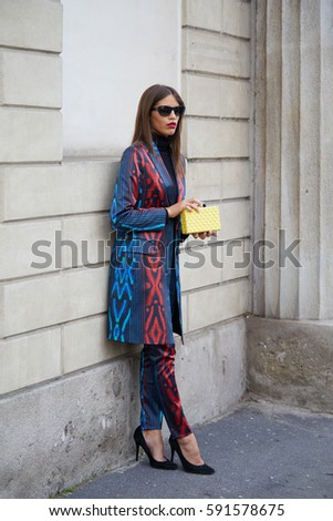 e188541f5 MILAN - FEBRUARY 24: Woman with red and blue suit and yellow bag before  Tod's fashion show, Milan Fashion Week street style on February 24, 2017 in  Milan.