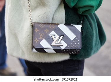 ca9810275 MILAN - FEBRUARY 24: Woman with small Louis Vuitton bag with black and  white design