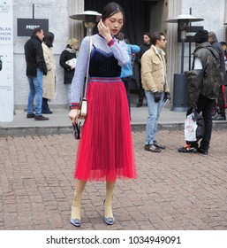 MILAN - FEBRUARY 25, 2018: A fashionable asian woman posing for photographers in the street before MSGM fashion show, during Milan Fashion Week Woman fall/winter 2018/19 in Milan, Italy.