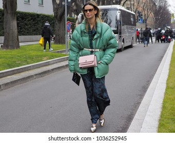 MILAN - FEBRUARY 25, 2018: Fashionable model posing for photographers in the street before ARMANI fashion show, during Milan Fashion Week Woman fall/winter 2018/19 in Milan, Italy.