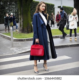 MILAN - FEBRUARY 25, 2018: Fashionable woman posing for photographers in the street before ARMANI fashion show, during Milan Fashion Week Woman fall/winter 2018/19 in Milan, Italy.