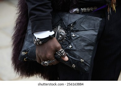 MILAN - FEBRUARY 25: Man black bag and rings before Gucci show Milan Fashion Week Day 1, Fall/Winter 2015/2016 street style day 1, on February 25, 2015 in Milan.