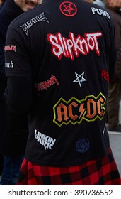 MILAN - FEBRUARY 25: Man poses for photographers with rock bands names on black t-shirt before Cristiano Burani fashion show, Milan Fashion Week Day 2 street style on February 25, 2016 in Milan.
