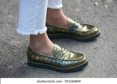 8d387b13bea MILAN - FEBRUARY 25  Woman with green metallic shoes and white torn jeans  before Ermanno