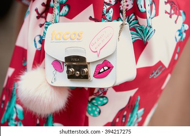 MILAN - FEBRUARY 25: Woman poses for photographers with Furla bag with Fendi fur and pink flamingo before Fendi fashion show, Milan Fashion Week Day 2 street style on February 25, 2016 in Milan.