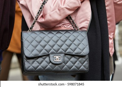 b5243c605f3f MILAN - FEBRUARY 26  Woman with black leather Chanel bag and pink satin  jacket before