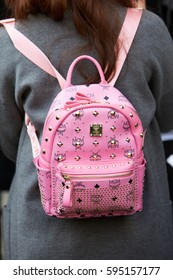 MILAN - FEBRUARY 26: Woman with MCM pink backpack with golden studs before Salvatore Ferragamo fashion show, Milan Fashion Week street style on February 26, 2017 in Milan.