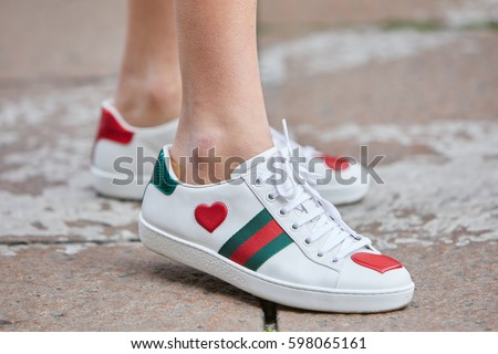 c3fb9f0e5f9 MILAN - FEBRUARY 26  Woman with white Gucci shoes with red heart and green  stripes