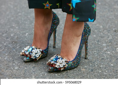MILAN - FEBRUARY 27: Woman with colorful glitter high heel shoes with gems and jewels decoration before Giorgio Armani fashion show, Milan Fashion Week street style on February 27, 2017 in Milan.
