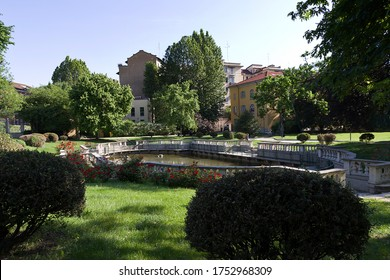 Milan - Guastalla Garden historic garden, the baroque fishpond enclosed by an elegant granite balustrade. Lombardy