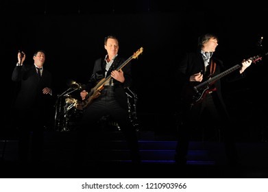 Milan  Italy  01 March 2010 : Live concert of Spandau Ballet at the Mediolanum Forum of Assago:  Tony Hadley,Steve Norman and Martin Kemp of the Spandau Ballet during the concert