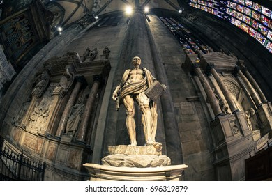 Milan, Italy - 07/03/2017: Interior view of Milan cathedral, shot with a fish eye lens. The statue of a saint is visible against a wall.