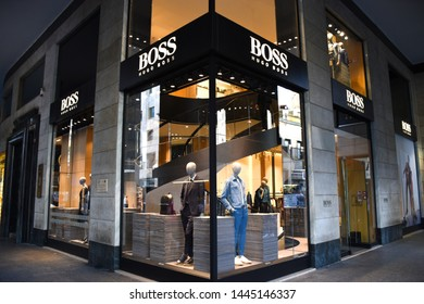 "Milan, Italy – 07.06.2019: Corner, storefront and entrance of the German luxury fashion house Hugo Boss in ""Corso Giacomo Matteotti"", the brand was founded in 1924 by Hugo Boss"