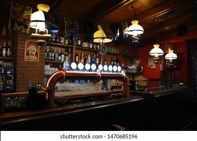 Milan, Italy, 08.04.2019: Interior of O'Connell Irish Pub with a long beer tap in the Brera Art District which is an artists' neighborhood and a place of bohemian atmosphere