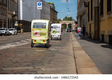 Milan, Italy 08.15.2019 Tuc-tuc transportation in Milan. Tricycle transportation and sightseeing tours