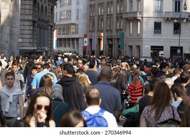 MILAN , ITALY - 10 April 2015: many people are walking to the city center on a spring day. It is customary on nice days to crowd the center for shopping