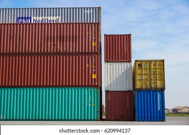 MILAN , ITALY 10 April 2017 : Several containers are ready to be loaded on to ships at the port. Containers are the classic method for maritime transport of different goods