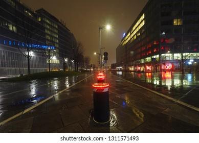 """MILAN, Italy: 10 February 2019: Milano in the night on Viale Francesco Restelli near """"Palazzo della Regione Lombardia"""" administrative Headquarters for the Italian Lombardy region in Milan, Lombardy."""