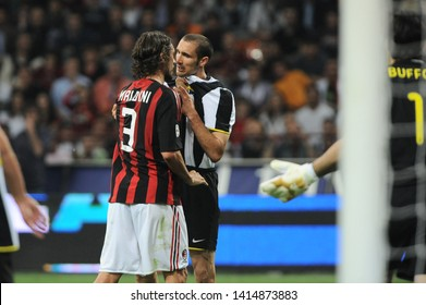 """Milan  Italy, 10 May 2009, """"G.MEAZZA SAN SIRO """" Stadium, Serious Football Championship A 2008/2009, AC Milan - FC Juventus  : Giorgio Chiellini and Paolo Maldini face to face during the match"""