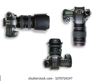 Milan, Italy - 10/08/2017: flat lay view of Canon EOS cameras on white background