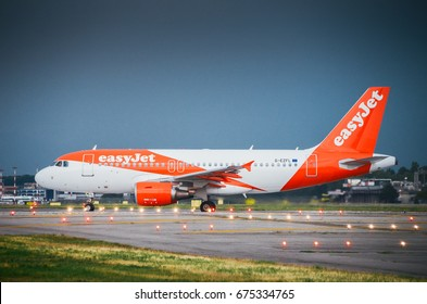 Milan, Italy. 10th July, 2017. An Easyjet commercial airplane lands at Milan's Linate airport. Linate is a main hub for Alitalia servicing many short and medium range destinations