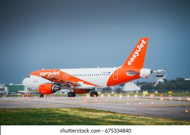 Milan, Italy. 10th July, 2017. An Easyjet commercial airplane lands at Milan's Linate airport. Linate is a main hub for Alitalia servicing many short and medium range