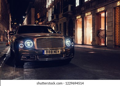 Milan, Italy 14 November 2018 Bentley Mulsanne new facelift stands on street parking slot at night with light on