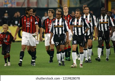 "Milan  Italy, 18 August  2002, ""G.MEAZZA SAN SIRO "" Stadium, XII Trofeo Berlusconi 2002/2003,  AC Milan - FC Juventus:The Milan and Juventus players enter the field before the match"