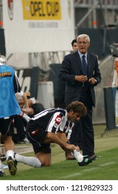 "Milan  Italy, 18 August  2002, ""G.MEAZZA SAN SIRO "" Stadium, XII Trofeo Berlusconi 2002/2003,AC Milan-FC Juventus:The coach of the Juventus, Marcello Lippi and the defender Ciro Ferrara during the"