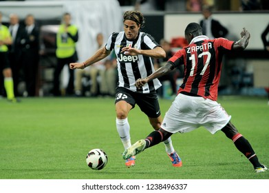 """Milan  Italy, 19 August  2012, """"G.MEAZZA SAN SIRO """" Stadium, Trofeo Berlusconi 2012/2013,  AC Milan - FC Juventus: Alessandro Matri and Zapata in action during the match"""