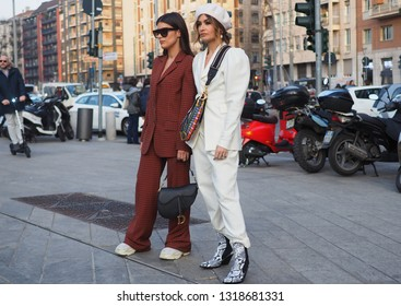 MILAN, Italy: 20 February 2019: Romina Introini and Dulceida streetstyle outfit before Alberta Ferretti fashion show during Milan fashion week Fall/winter 2019/2020