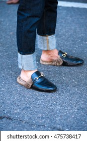 Milan, Italy, 20 June 2016 - man poses for photographers in leather slipper before ARMANI fashion show on Milan Men's Fashion Week street style Spring/Summer 2017