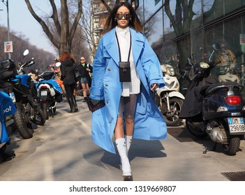 MILAN, Italy: 21 February 2019: Fashion blogger street style outfit before Armani fashion show during Milan fashion week Fall/winter 2019/2020