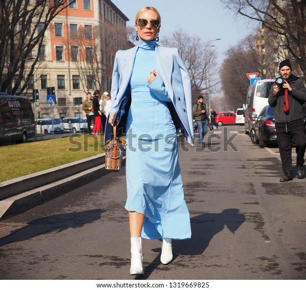 MILAN, Italy: 21 February 2019: Fashion bloggers streetstyle outfit before Armani fashion show during Milan fashion week Fall/winter 2019/2020