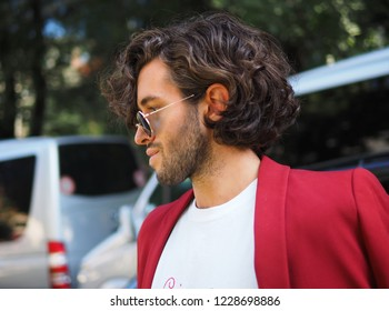 MILAN, Italy: 23 September 2018: Eccentric man in street style outfit before Armani Fashion show 2018 during Milano Fashion week fall winter 2018/2019.