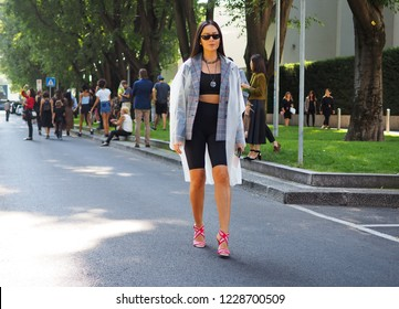 MILAN, Italy: 23 September 2018: Woman in street style outfit before Armani Fashion show 2018 during Milano Fashion week fall winter 2018/2019.