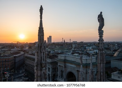 Milan, Italy - 25 April , 2018: The sun sets behind the spires of the Duomo Cathedral, Duomo di Milano, the most famous landmark of the city.