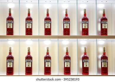 MILAN, ITALY - 4 SEPTEMBER 2013: Bottles of Campari stand in an illuminated display case inside a gallery.
