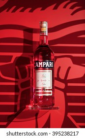 MILAN, ITALY - 4 SEPTEMBER 2013: A bottle of Campari stands on display  inside a gallery.