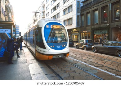 Milan Italy 5 December 2018: Tram on rails in Milan stopped with passengers