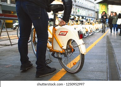 Milan Italy 5 December 2018: A person takes a public bicycle in the municipality of Milan