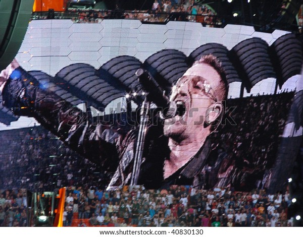 MILAN, ITALY - 8, JULY: U2 rock band perform during the U2 360° Tour concert , on the 8 July, 2009 in Milan, Italy.