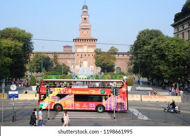 Milan , Italy 8,2018 - Red city sigthseeing bus for tourist that visiting the city of Milano , Downtown and Sforza Castle ( Castello )