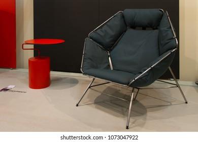 MILAN, ITALY - APR 19, 2018: Products displayed at Salone Satellite during the week of Milan Furniture Fair 2018, designer Tine Riisbol (chair), Thomas Bundgaard (table).