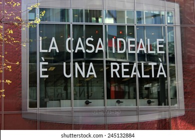 MILAN, ITALY - APR 9: Ideal Home is a reality (La casa ideale e una realta ), a script on a window inside the Milan Furniture fair on April 9 2014