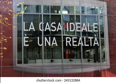 MILAN, ITALY - APR 9: Ideal Home is a reality (La casa ideale e una realta), a script on a window inside the Milan Furniture fair on April 9 2014