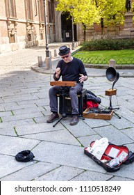 MILAN, ITALY - APRIL 07, 2018: Musician plays theremin on the street of Milan. It is an electronic musical instrument played with hands without physical contact.