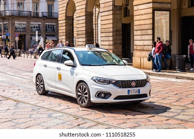 MILAN, ITALY - APRIL 07, 2018: View of a taxi in the street near La Scala theatre in Milan.